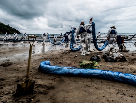 oil spilled beach operation in Thailand
