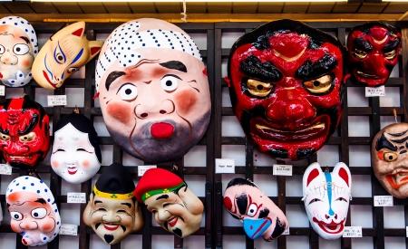 souvenir traditional: funny masks at a shop in Tokyo, Japan Editorial