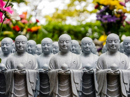 monks sculpture in a temple in Japan photo