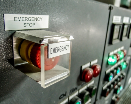 emergency stop botton in electrical control panel in industrial plant photo