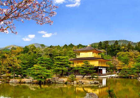 pavillion: beautiful lanscape of the famous golden pavilion of Kinkakuji temple with sakura branch, Kyoto, Japan
