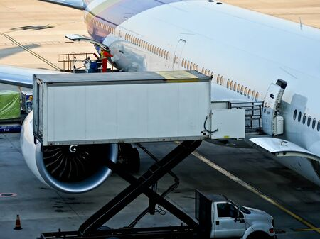 loading truck: cargo loading to airplane at the airport