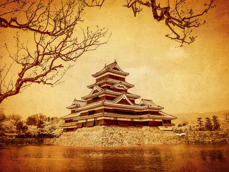 Matsumoto castle in old paper background, Japan