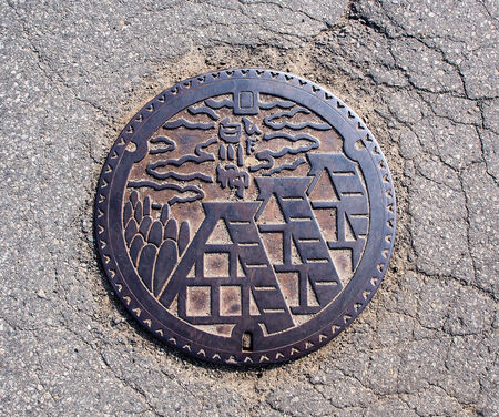 Drainage cover at Shirakawa-go village, Japan photo