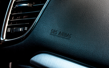 air bag warning sign in a car photo