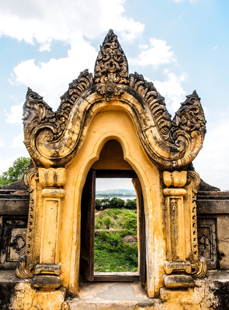 nu: Ancient door at Maha Aung Mye Bon Zan Monastery in Ava, Myanmar Stock Photo