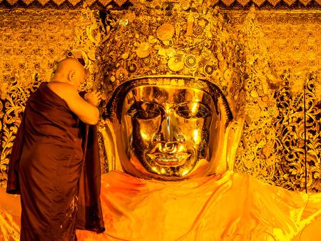 ritual of the Buddha image face wash at Mahamuni temple in Mandalay, Myanmar