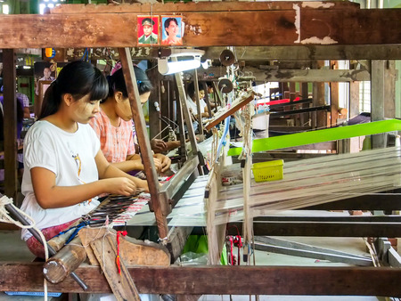 hand woven: Burmese worker work with traditional loom machine