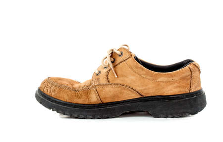 old brown leather shoe on white background photo
