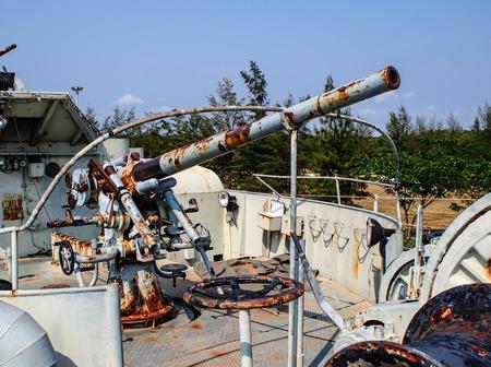 a battleship: old battleship cannon Editorial