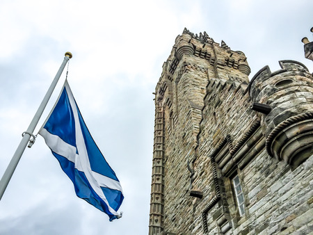 scottish: National Wallace Monument with Scotland flag in Stirling, UK