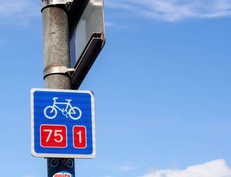 bicycle lane: bicycle lane sign with blue sky