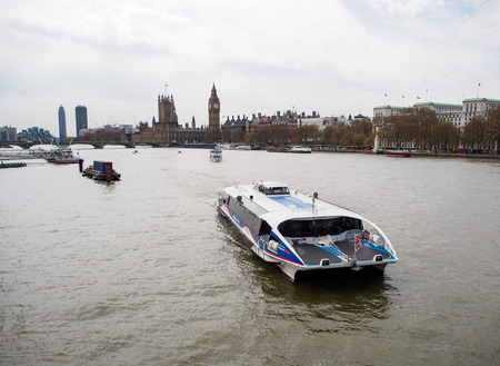 tourist city cruise in Thames river, London, UK Stock Photo