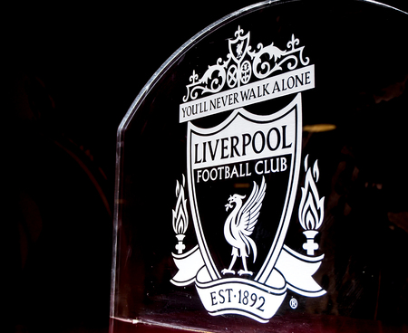Liverpool football club crest on glass in Anfield stadium, Liverpool, UK Editorial
