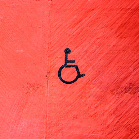 handicap sign: handicap sign on red wall