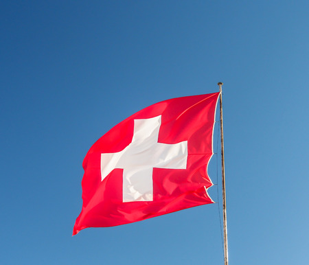 european: Swiss flag with blue sky