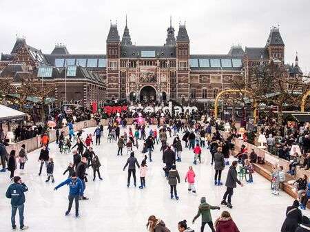people on ice skating in front of Rijksmuseum, Amsterdam, Netherlands