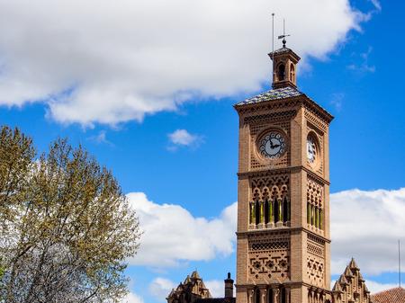 cash register building: clock tower of Toledo train station, Spain