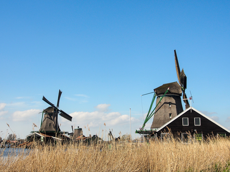 Dutch traditional windmills with blue sky, Netherlands Stock Photo