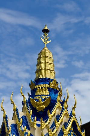 Ancient Thai spirit house with blue sky and cloud