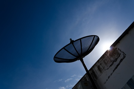 Sattlellite dish on the roof with sunfare Stock Photo - 10191990
