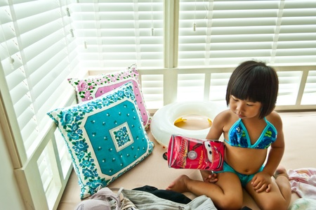 Little asians girl with swiming suite photo