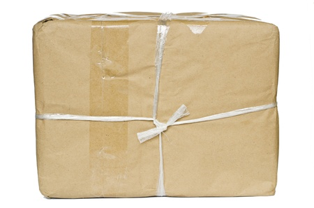 A parcel wrapped in brown paper and tied with rough twine and blank label, isolated on white background Stock Photo