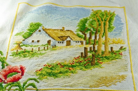 cross stitch with spring house show texture and pattern photo
