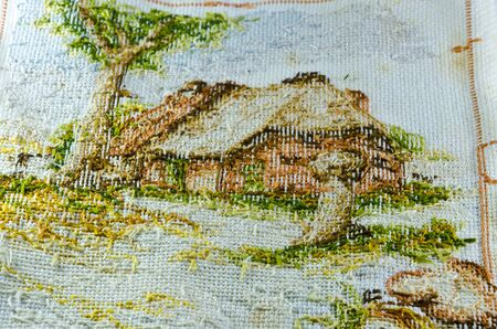 back side of old cross stitch show pattern and texture