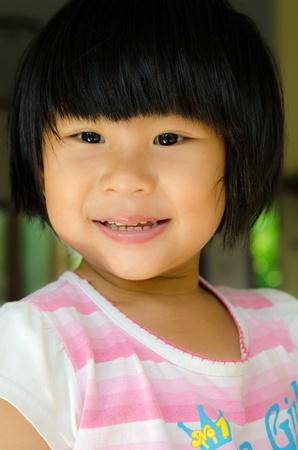 black hair blue eyes: Happy asian girl smile on her face