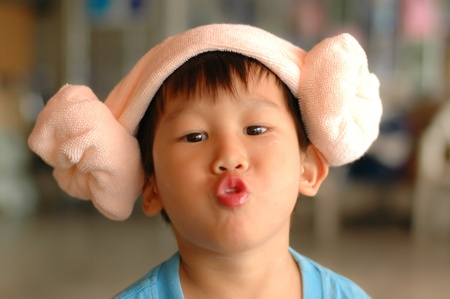 Asian boy with funny towel hat