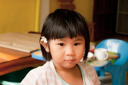 A little girl put jasmin flower on her ear Stock Photo - 11156408