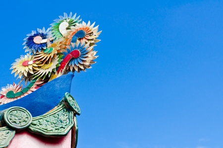 Part of chinese roof with blue sky photo