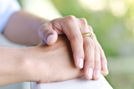 Hand in hand with golden ring,spirit concept Stock Photo - 11345906