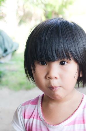 Asian little girl eating