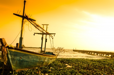 fisherman on boat: Old blue fishing boat struck on beach Stock Photo