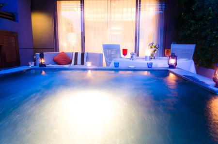 Romantic dinner with jacuzzi for night views Stock Photo