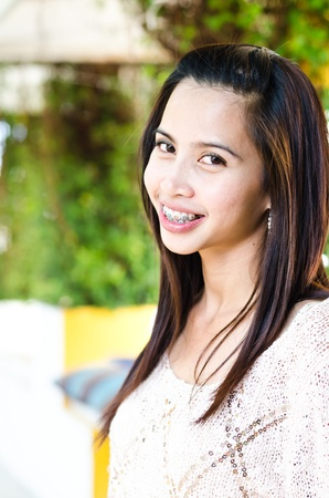 Beautiful attractive woman with teeth braces Stock Photo