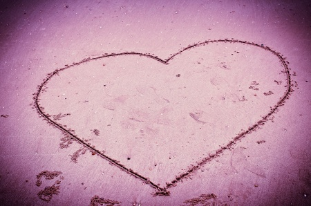 Heart drawn on sand for background