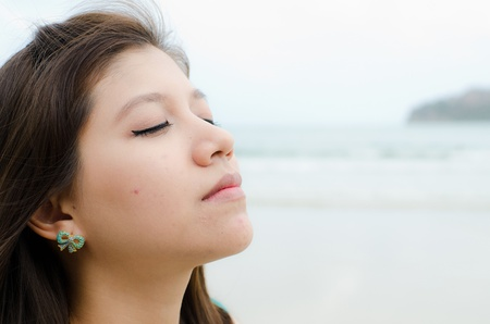 Attractive Asian woman enjoy on the beach, headshot