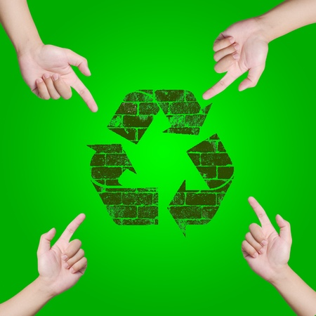 Hand pointing Recycle sign  Save the world concept Stock Photo - 12782341