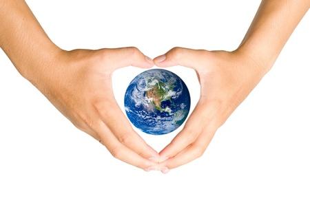 energy healing: Mano che tiene gli Elementi Terra blu di questa immagine forniti dalla NASA Archivio Fotografico