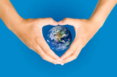 Hand holding the blue Earth  Elements of this image furnished by NASA photo