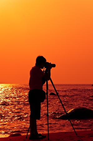 Photographer with sillouette in Hua Hin Beach photo