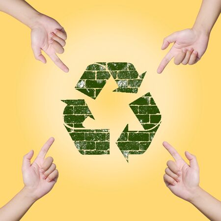 Hand pointing Recycle sign. Save the world concept Stock Photo - 12782368