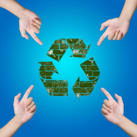 Hand pointing Recycle sign  Save the world concept  photo