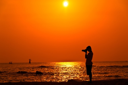 Photographer with sillouette on Hua Hin Beach Stock Photo - 12924724