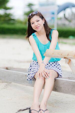 Happy Asian Woman on the beach photo