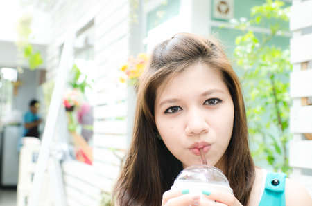 Beautiful woman enjoy her drink photo