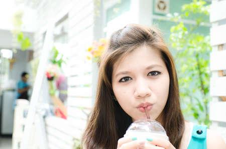 Beautiful woman enjoy her drink photo